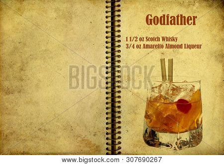 Old,vintage Or Grunge Spiral Recipe  Notebook With Godfather  Cocktail  On The Page.room For Text