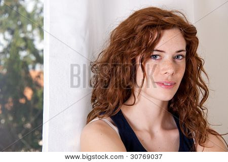 Young Beautiful Woman With Red Hair And Blue Eys