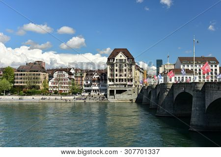 Basel, Switzerland - April 17, 2019. View Of The Middle Bridge Across The Rhine River On A Spring Su