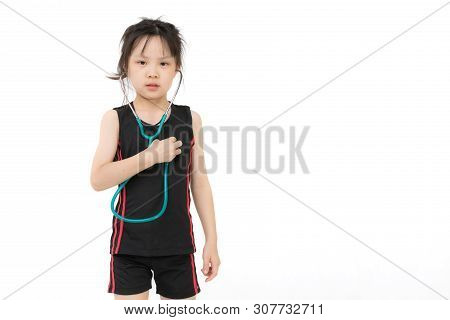 Pretty Asian Girl In Sportswear Wears Green Stechoscope And Posing To Camera, Studio Shot On White B