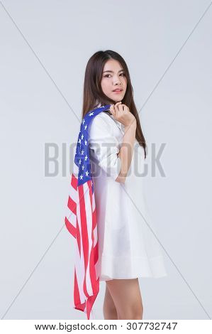 Young And Beautiful Happy Smile Face Asian Woman Holding American Flag And Rise Over Head With Pride
