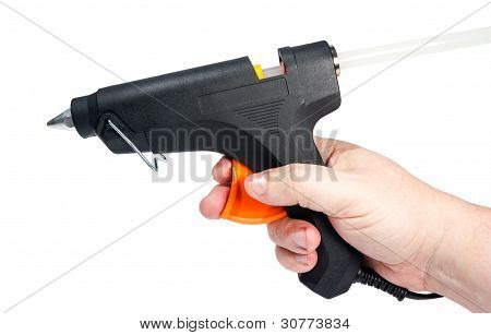 Electric hot glue gun in hand isolated on a white background. poster