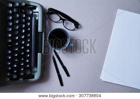 Literature, Author And Writer, Writing And Journalism Concept: Typewriter, Cup Of Coffee And Glasses