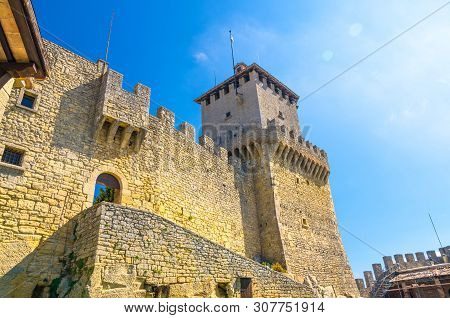 Prima Torre Guaita First Medieval Tower With Stone Brick Fortress Wall With Merlons On Mount Titano