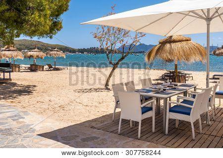 Mallorca, Spain - May 6, 2019: Restaurant On The Seaside Promenade In Port De Pollenca (puerto Polle