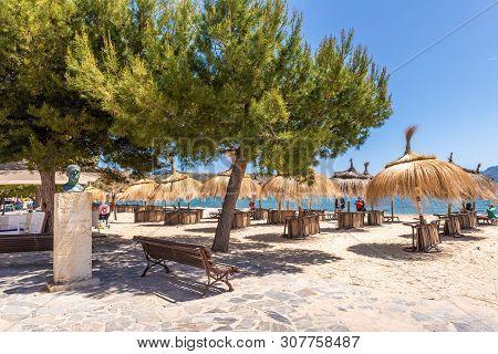 Mallorca, Spain - May 6, 2019: View Of The Beach In Port De Pollenca (puerto Pollensa), A Popular Fa