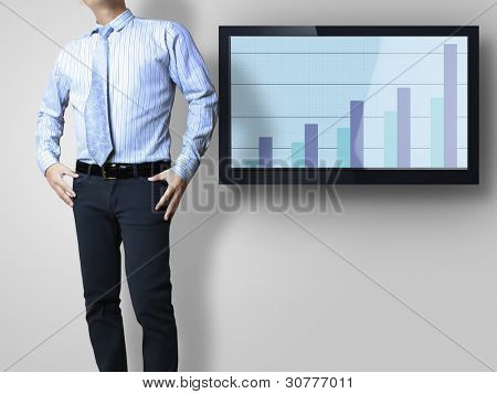 young businesspeople  front of a huge plasma TV screen