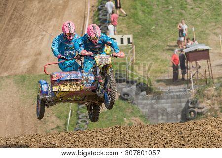 Brezova Nad Svitavou, Czech Republic - June 15, 2019: Sidecars With Pink Helmets Jumping Internation