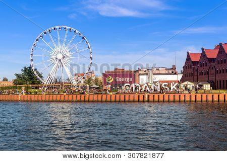 Gdansk, Poland - June 22, 2019: Ferris Wheel On The Motława River In The Old City Of Gdansk