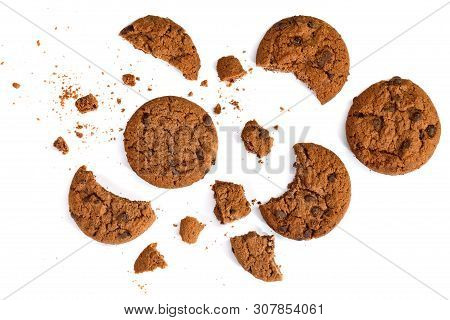 Round Chocolate Chip Cookies And Crumbs Isolated On White Background. Top View.