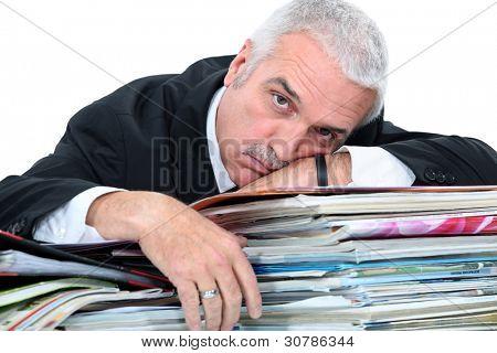 Man lying on paperwork