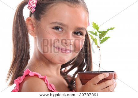 Young girl with an oak sapling
