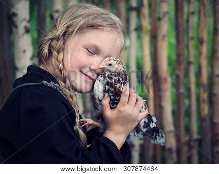 A Girl With A Bird. Emotional Portrait Of A Child With A Pet