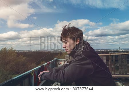 Portrait Of A Young Man On A Windy Day