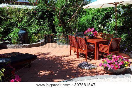 Beautiful Summertime Mediterranean Style Courtyard Garden Setting.