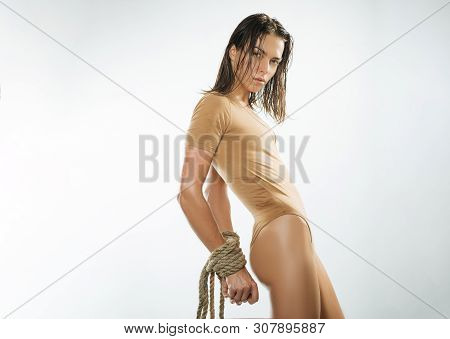 Bondage Or Bdsm. Sensual Woman Tied With Rope Bondage. Sexy Girl Practicing Bondage Art. Bondage And