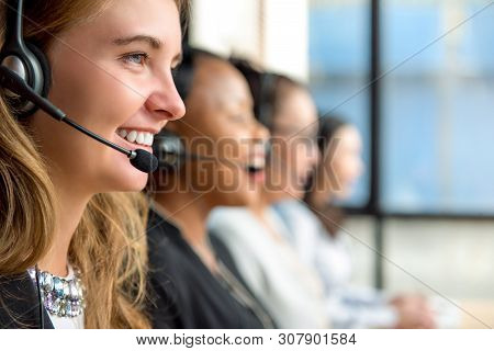 Friendly Beautiful Caucasian Woman Telemarketing Customer Service Agent Working In Call Center With