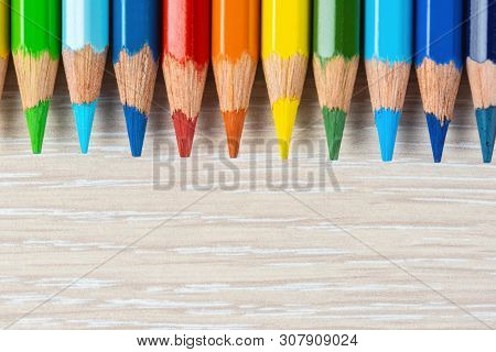 Set Of Colored Pencils. Colors Of Rainbow. Colored Pencils For Drawing Different Colors On A Light B