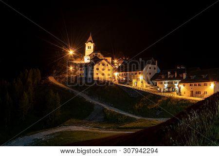 Ancient Village Of Monte Santo Di Lussari (1790 M) At Night In The Julian Alps. Tarvisio, Friuli Ven