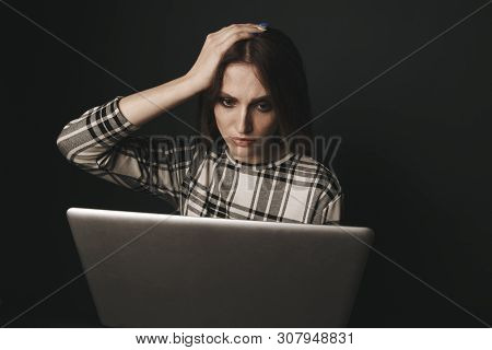 Teen Girl Excessively Sitting At The Computer Laptop At Home. He Is A Victim Of Online Bullying Stal