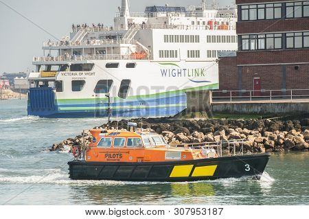 Portsmouth, Uk - April 1: Wightlink Ferry And Pilot Tug In The Historic Naval Dockyard Port Of Ports
