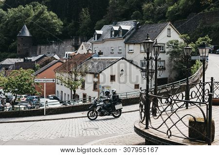 Vianden, Luxembourg - May 18, 2019: Motorcyclist On A Cobblestone Street In Vianden, Town In Luxembo