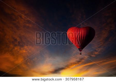 Red Hot Air Balloon In The Shape Of A Heart, Colorful Hot-air Balloon Flying Over Sunset