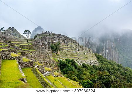 Ancient inca lost city of Machu Picchu, lanscaped and on the top of a mountain