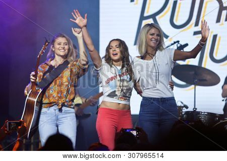 NASHVILLE, TN - JUN 3: (L-R) Hannah Mulholland, Naomi Cooke and Jennifer Wayne of Runaway June perform at CMT's RAMJAM at TopGolf on June 3, 2019 in Nashville, Tennessee.