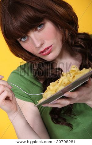 Woman eating tagliatelle