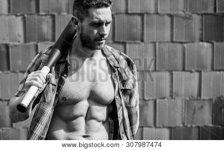Power And Strength. Feel My Strength. Man Unshaven Face Muscular Torso Hold Black Baseball Bat. Stro
