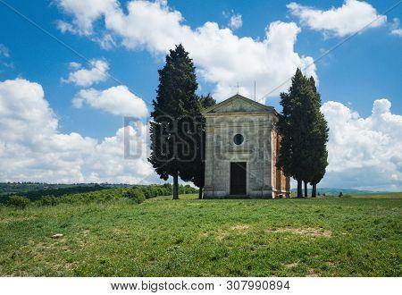 Chapel of Capella di Vitaleta in the Tuscan landscape of the Val dOrcia poster