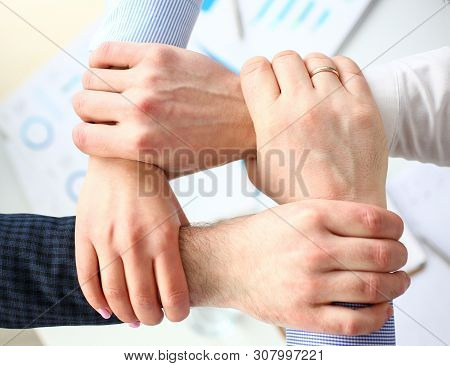 Business People Making Routine Sign With Hands For Teamspirit Above Working Table Closeup