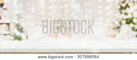 Empty White Wold Table Top With Abstract Warm Living Room Decor With Christmas Tree String Light Blu