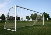 A vacant soccer goal with no one around it. poster