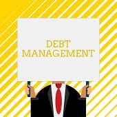 Handwriting text writing Debt Management. Concept meaning The formal agreement between a debtor and a creditor Old fashioned way to pick people at airport hold big board with two hands. poster
