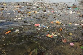 SEMPORNA, MALAYSIA - 19 JUNE 2019: Plastic pollution in ocean environmental problem. Plastic bottles, bags, cups and straws pollute ocean.