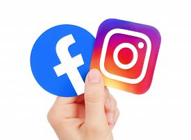 Kiev, Ukraine - May 15, 2019: Hand Holds New Facebook Logo And Instagram Printed On Paper. Instagram