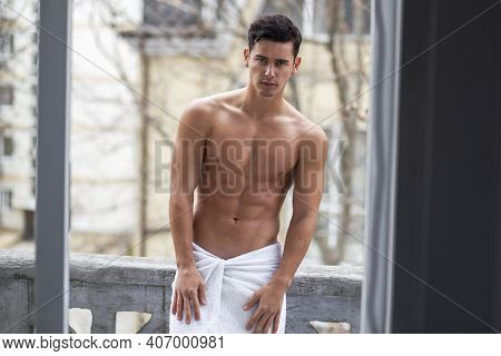 Shirtless, Athlete Handsome Man Poses On Balcony With Naked Torso In Outside.