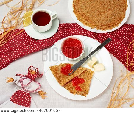 Pancakes With Red Caviar On The White Plate. Staple Of Yeast Pancakes, Traditional For Russian Panca