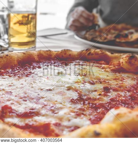 Pizza Margherita And Beer Served In A Restaurant. Shallow Dof. Retro Style Photo For Social.