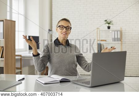 Young Positive Woman Office Worker Gesticulating During Online Communication Teleconference