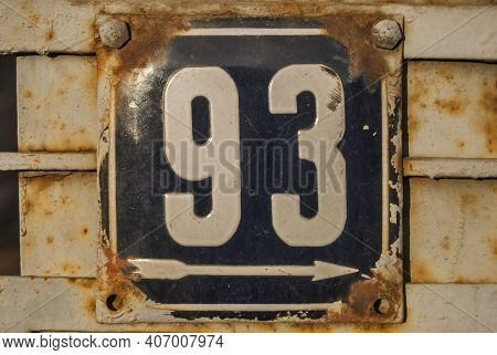 Weathered Grunge Square Metal Enameled Plate Of Number Of Street Address With Number 93