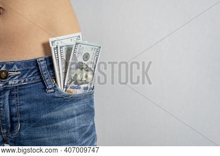 100 Dollar Bills Stick Out Of The Front Pocket Of His Jeans, The Concept Of Money In Your Pocket. Ho