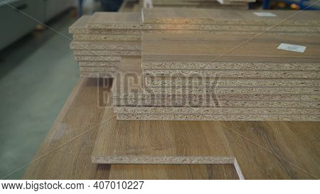 Woodworking Industry And Furniture Assembly Concept. Fiberboard At A Furniture Factory. Boards At Th