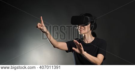 Girl With Hands Up Wearing The Vr Headset Goggles Getting Cyber Experience.
