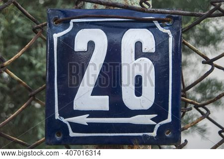 Weathered Grunge Square Metal Enameled Plate Of Number Of Street Address With Number 26
