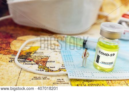 Miniature People : Doctor Stand On Medical Mask With Covid-19 Vaccine  And Syringe. Vaccine And Heal