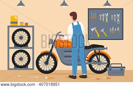 Male Mechanic Is Customizing Motorcycle At Service Garage. Man In Overall Is Fixing And Making Bike