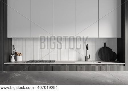 Grey Kitchen Room With White Kitchen Set With Shelves, Kitchen Appliances And Stove. Faucet And Cutt